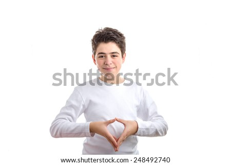 Hispanic smooth-skinned teen in a white long sleeved t-shirt  smiling makes reverse hand steeple gesture - stock photo