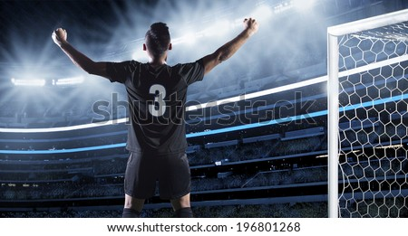 Hispanic Soccer Player Celebrating a Goal - stock photo