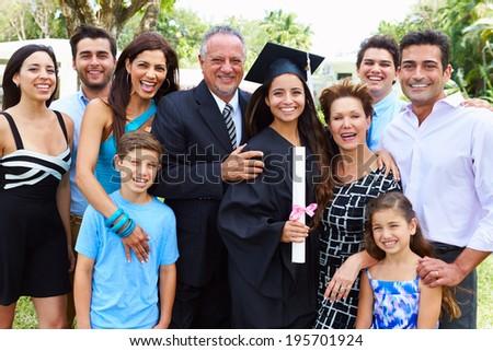 Hispanic Student And Family Celebrating Graduation - stock photo