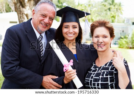Hispanic Student And Parents Celebrate Graduation - stock photo