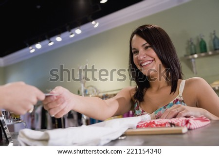 Hispanic woman clothing shopping - stock photo