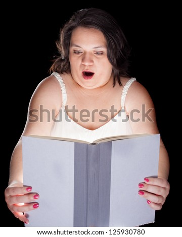 hispanic woman holding an open book with light coming out of it - stock photo