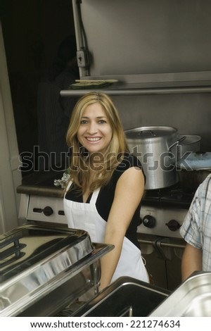 Hispanic woman in commercial kitchen - stock photo