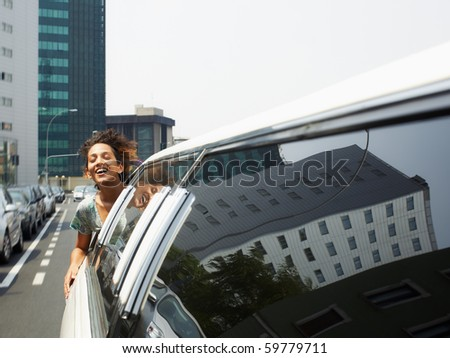 hispanic woman in limousine with head out of car window. Horizontal shape, copy space