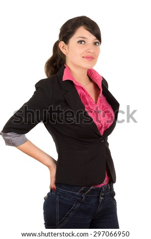 Hispanic woman in pink shirt and black blazer jacket upper body shot arms placed behind lower back looking at camera. - stock photo
