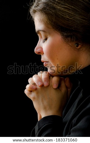 Hispanic woman praying to his Saviour in heaven. Religious protestant concept - stock photo