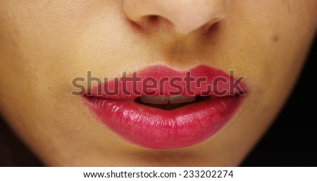Hispanic woman's red luscious lips