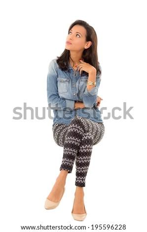 hispanic woman sitting on a white background - stock photo