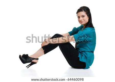 Hispanic woman sitting wearing blue top - stock photo