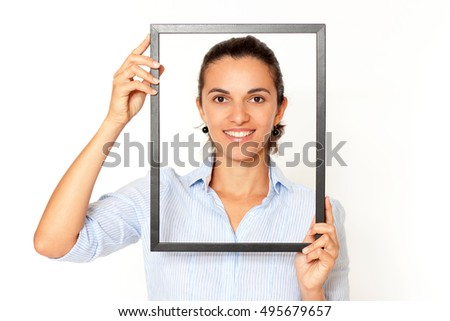 Hispanic woman with a frame smiling