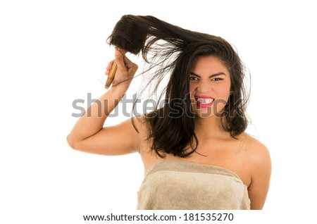 hispanic woman with wild brunette hair on white background - stock photo