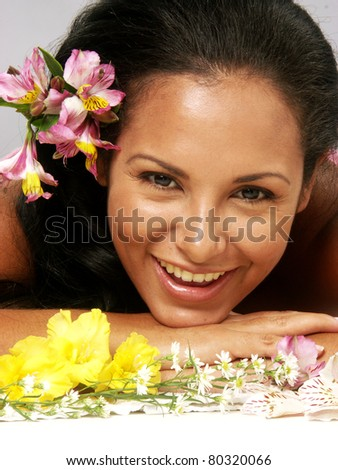 Hispanic young woman portrait with flowers.