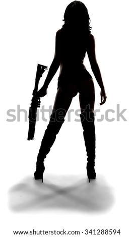 Hispanic young woman with long black hair in intimate/nude outfit holding shotgun - Isolated - stock photo