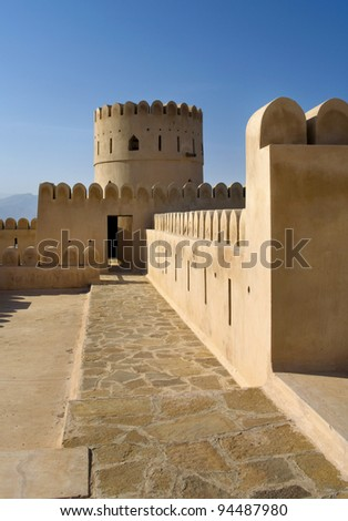Historic adobe fortification, watchtower of Sunaysilah Castle or Fort in Sur, Al Sharqiya Region. Sultanate of Oman,  Middle East - stock photo