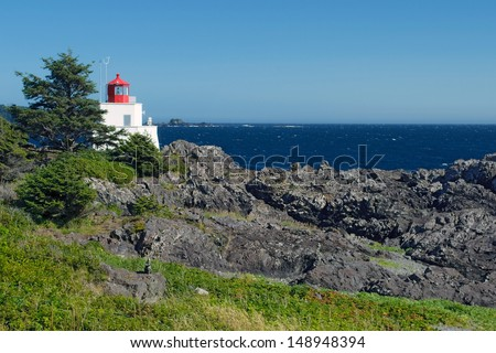 historic Amphitrite Lighthouse in Ucluelet, Vancouver Island, on the Wild Pacific Trail - stock photo