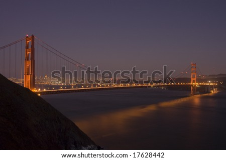 Historic and famous Golden Gate bridge at night with San Francisco in the distance from the Marin headlands