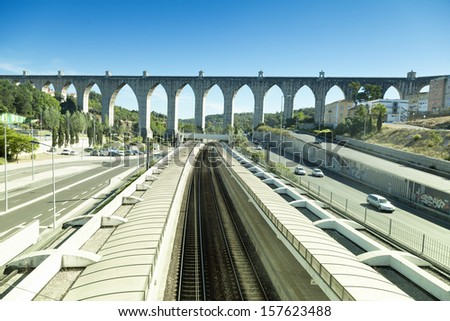 historic aqueduct in the city of Lisbon  - stock photo