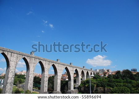 historic aqueduct in the city of Lisbon built in 18th century, Portugal - stock photo