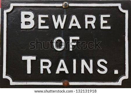 Historic Beware of Trains railway sign.