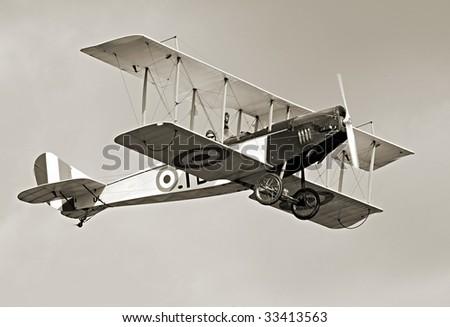 Historic biplane on the sky - vintage photography - stock photo