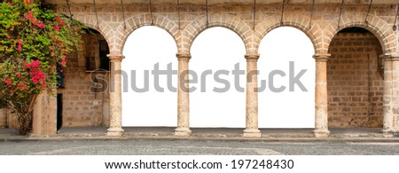 Historic building with isolated arches and flowers - stock photo