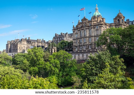 Historic buildings and a green park in Edinburgh, Scotland - stock photo