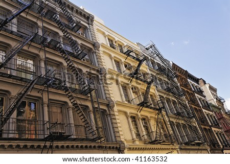 Historic buildings on Greene Street in the SoHo Cast Iron Historic Destrict in New York. - stock photo