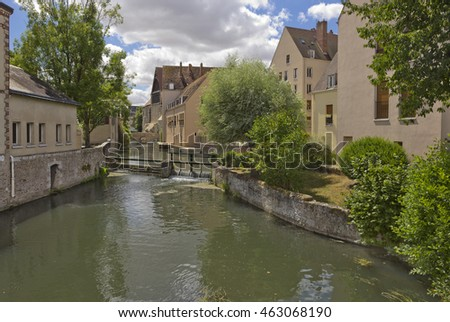 Historic buildings on the bank of Eure River in Chartres, France
