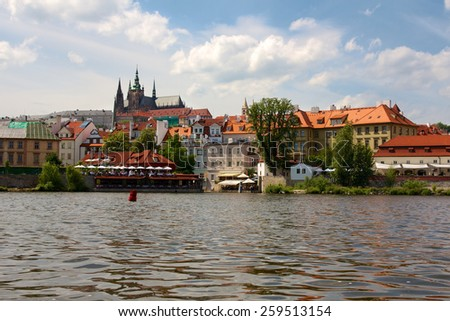 Historic buildings on the Vltava river in Prague, Czech Republic. - stock photo