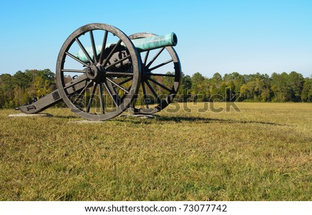 historic cannon on a battlefield - stock photo