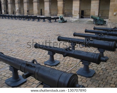 Historic cannon on the square in museum Les Invalides, Paris, France.