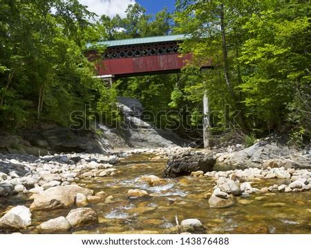 Historic Chiselville Bridge (c. 1870) over the Roaring Branch Brook in Arlington, Vermont - stock photo