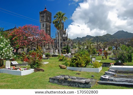 Historic church building and cemetery on tropical Saint Vincent island  - stock photo