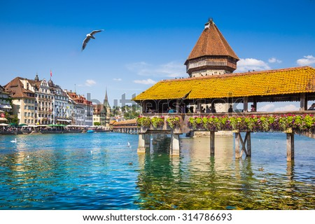 Historic city center of Lucerne with famous Chapel Bridge, the city's symbol and one of Switzerland's main tourist attractions and views on a sunny day in summer, Canton of Lucerne, Switzerland