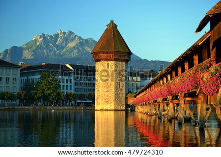 Historic city, Lucerne with Chapel Bridge, the city's symbol, main tourist attractions on a morning sunrise in summer and backdrop is Pilatus mountain, Canton of Lucerne, Switzerland