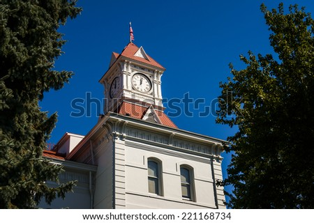 Historic clock tower in old courthouse - stock photo