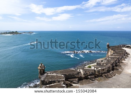 Historic colonial fortification walls overlooking San Juan Bay in Puerto Rico - stock photo