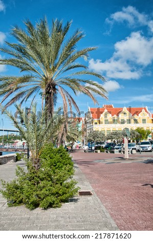 Historic colorful dutch buildings in Willemstad, Curacao, Dutch Antilles on a blue sky day - stock photo