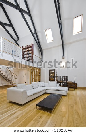 historic conversion apartment with mezzanine and hard wood beam construction - stock photo