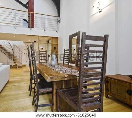 historic conversion apartment with mezzanine and luxury furniture - stock photo