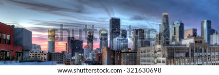 Historic Core and Financial District of Downtown Los Angeles during sunset.  The image shows smog and pollution.  All building logos has been edited out. - stock photo