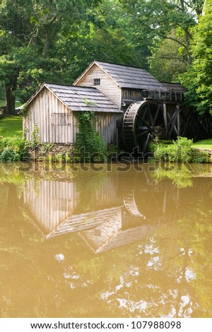 Historic Edwin B. Mabry Grist Mill (Mabry Mill) in rural Virginia on Blue Ridge Parkway and reflection on pond in summer