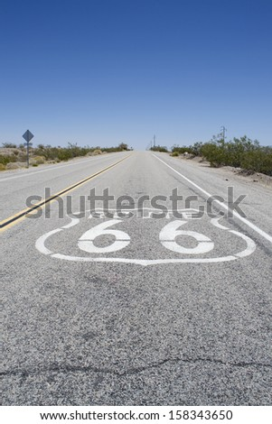 Historic endless Route 66 crossing the Mojave Desert in California - stock photo