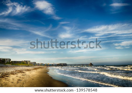 Historic fishing pier and beach scene at Cocoa Beach, Florida - stock photo