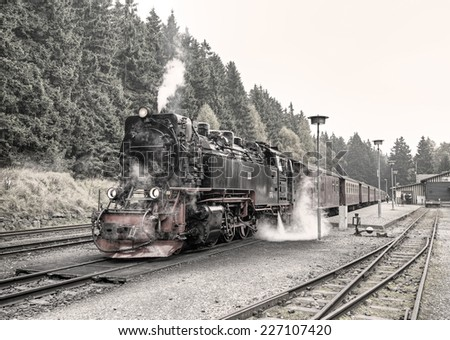historic German black steam powered railway train at Schierke station, Schierke, Harz, Germany, Europe, vintage style - stock photo
