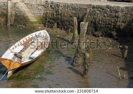 Historic harbour of Lyme Regis with Cobb wall in Dorset - stock photo