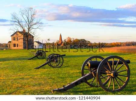 Historic Henry House and cannons at Manassas National Battlefield Park during sunset - stock photo