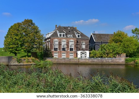 Historic house at Kinderdijk,a UNESCO heritage site in the Netherlands - stock photo