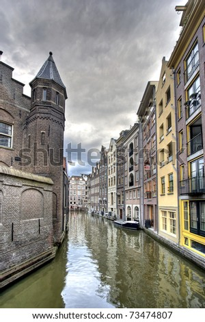 Historic houses on Amsterdam canal - stock photo