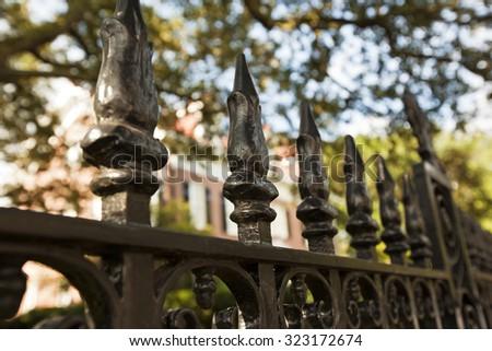 Historic iron fences line the streets of Charleston, South Carolina - stock photo